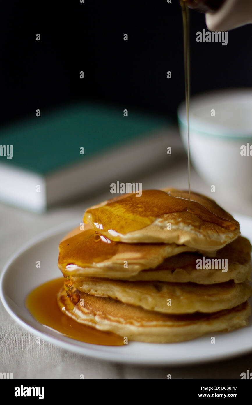 Pancakes with maple syrup. - Stock Image