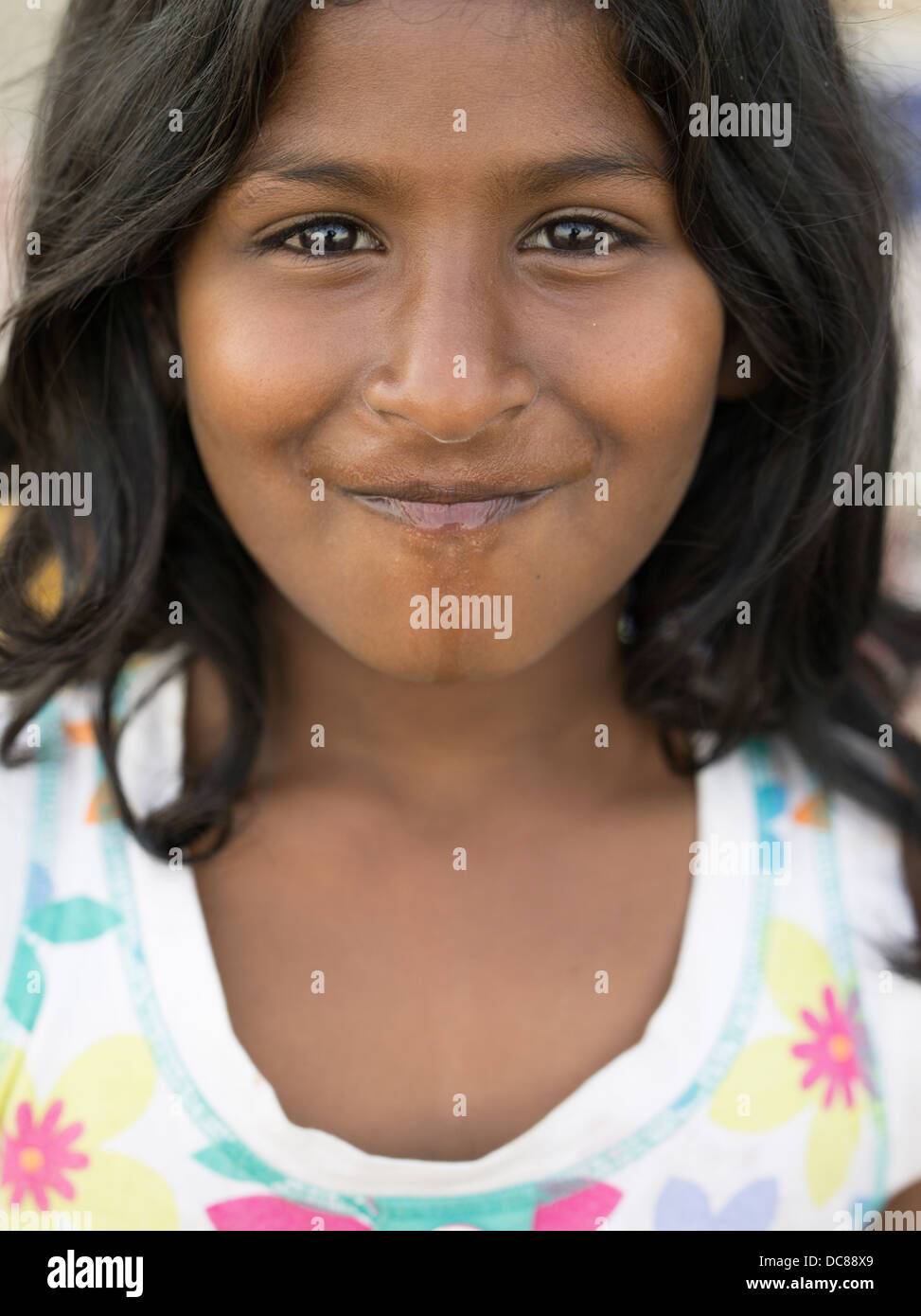 2b5d31ef5a Portrait of young beautiful Indian girl by the Ganges River ( Varanasi )  India - Stock