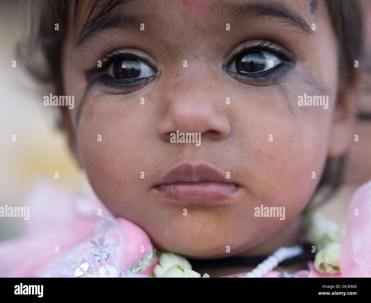 Young Indian girl wearing Heavy eyeliner possibly Kohl made from galena (lead sulphide /  sulfide) - Stock Image