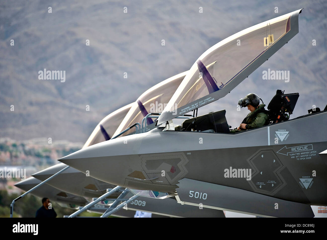 US Air Force Capt. Brad Matherne conducts preflight checks inside an F-35A Lightning II stealth fighter aircraft - Stock Image