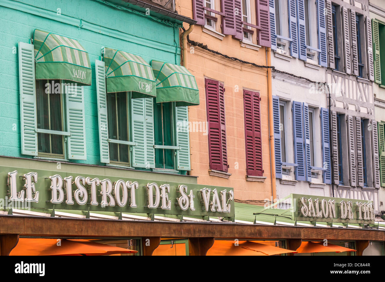 Colourful windows and shutters above cafe bars in Saint-Valery-sur-Somme, a commune in the Somme department, northern - Stock Image