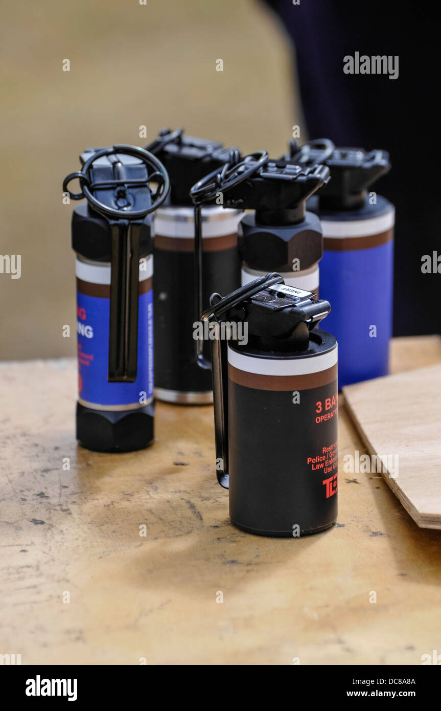 Five smoke and blast grenades, used by police and military to disorientate and distract targets. - Stock Image