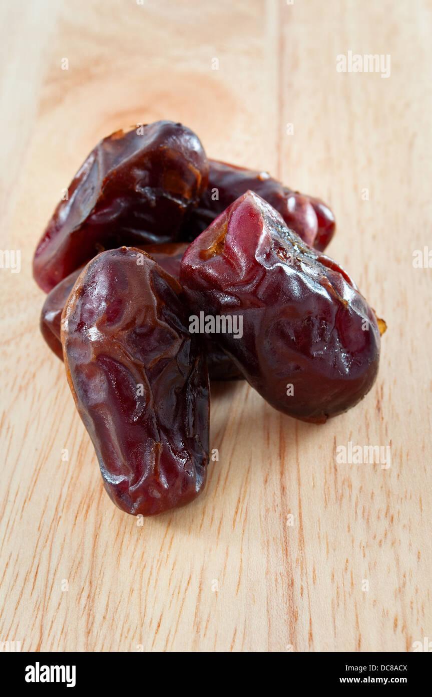 Dates fruit board group ingredient organic food - Stock Image
