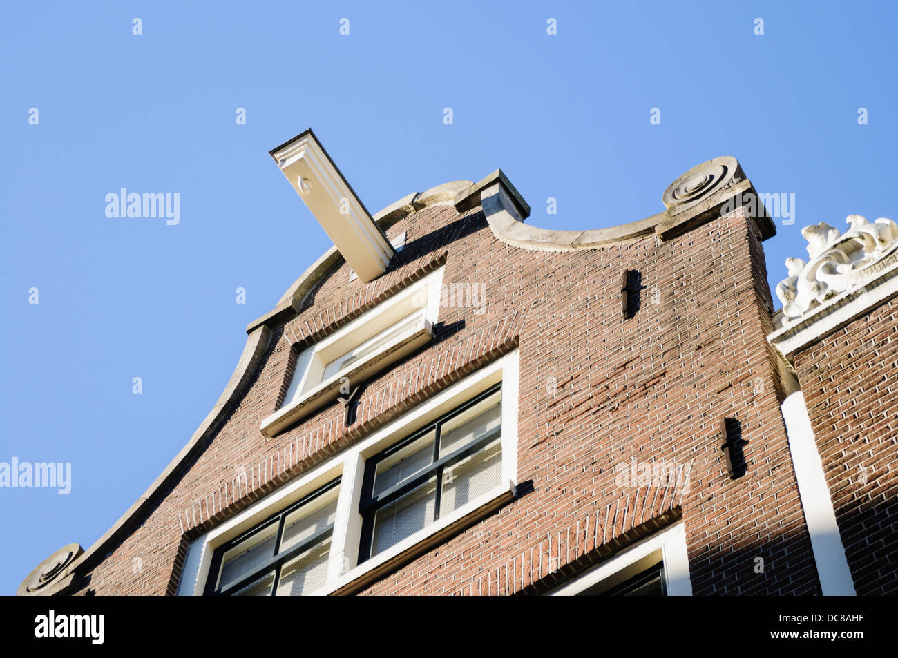 Hook on the roof of a house in Amsterdam, to allow owners to winch furniture and large objects into upper floors - Stock Image