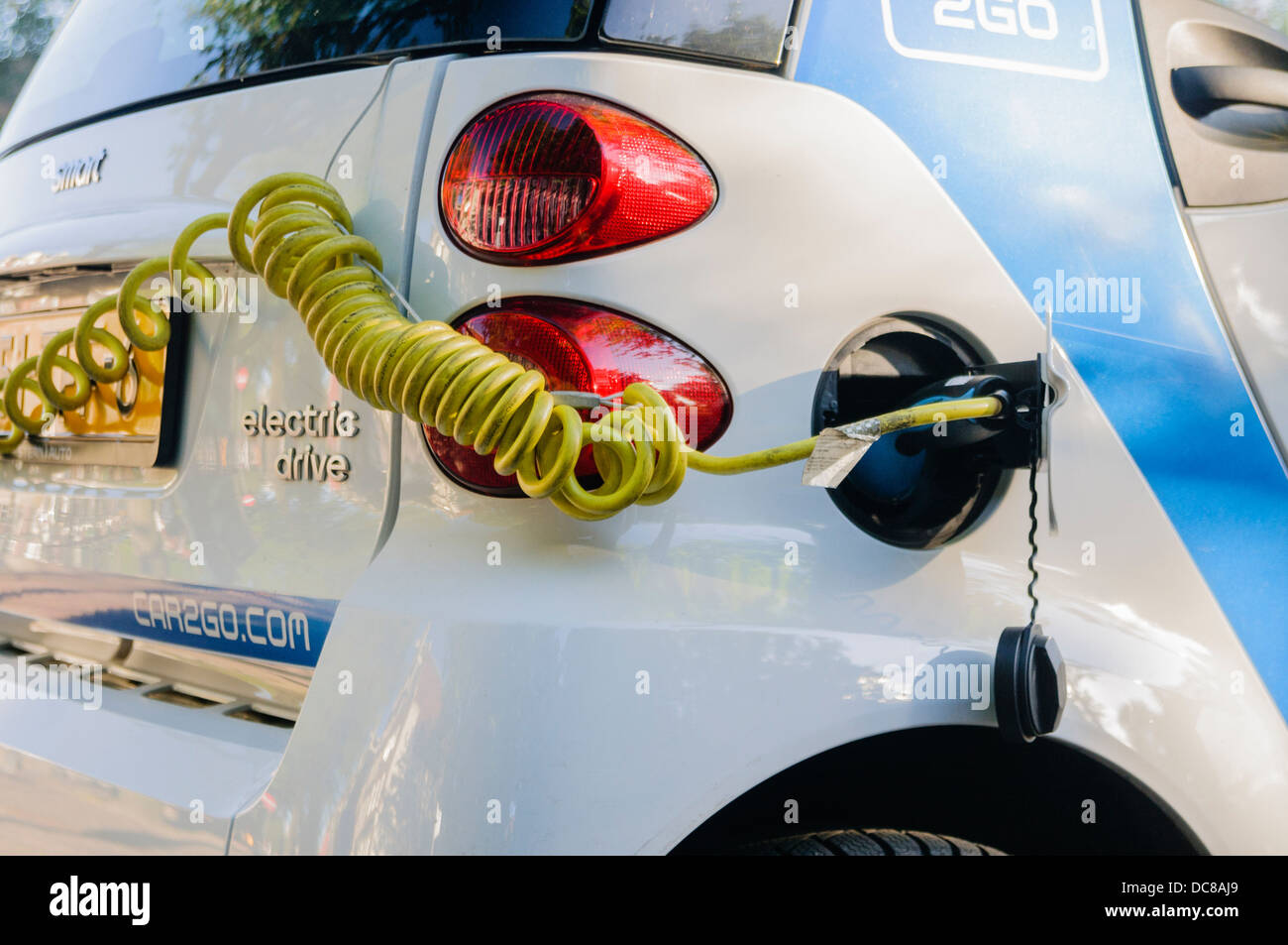 Electric car being recharged - Stock Image