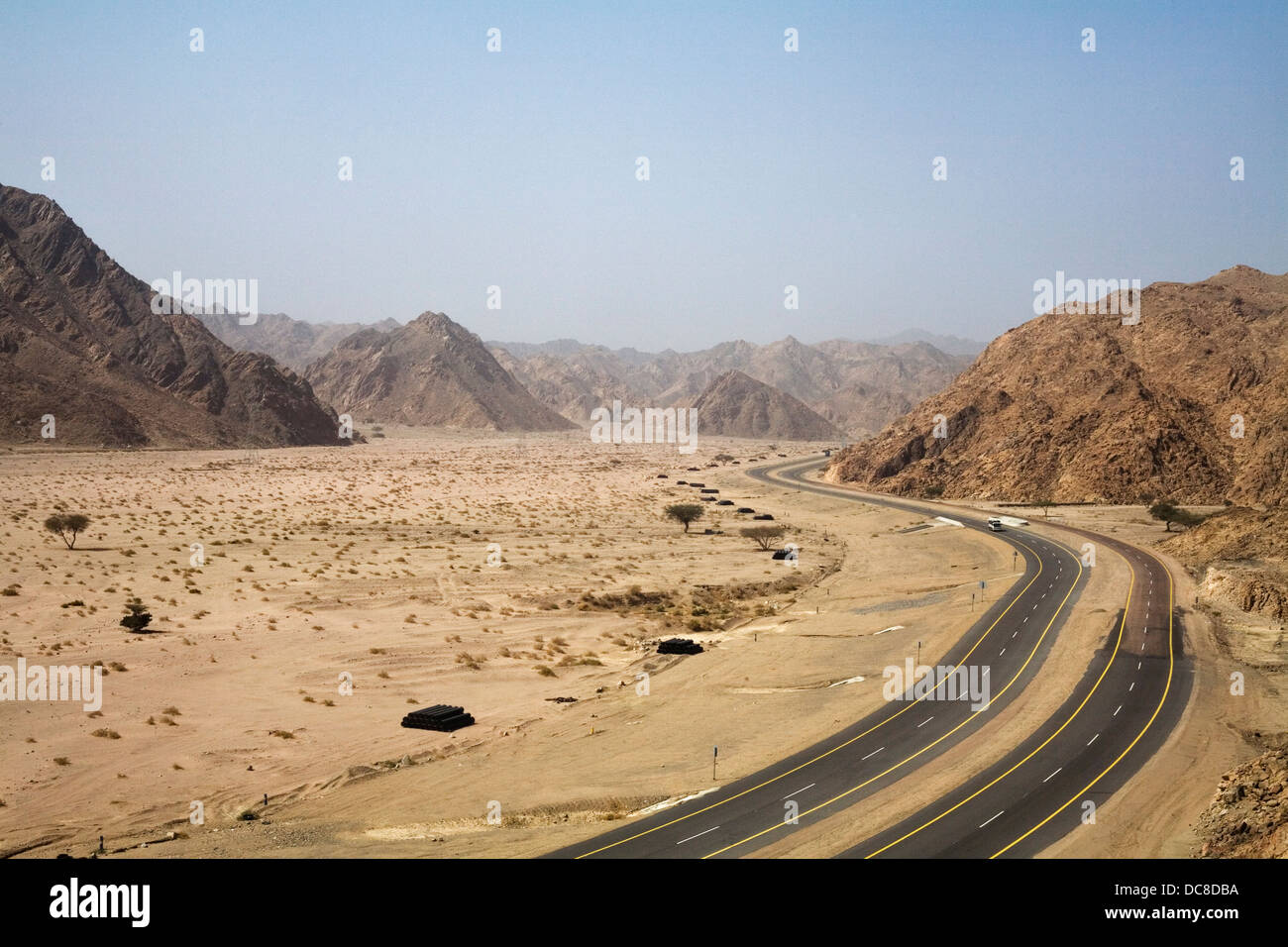 The Duba-Haql number 5 highway passing through the Sarawat Mountains in north west Saudi Arabia. - Stock Image