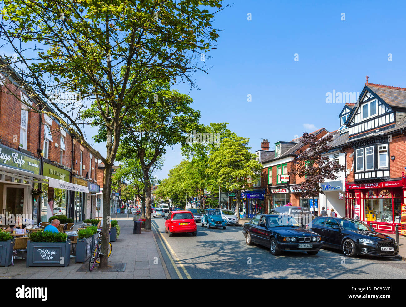 Cafe and shops on the High Street ( London Road ) in the village centre, Alderley Edge, Cheshire, England, UK - Stock Image