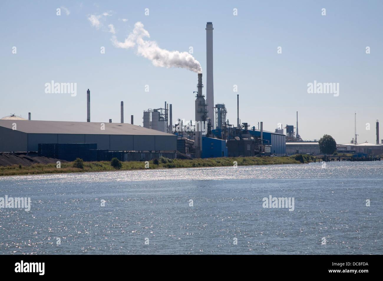 Chimneys heavy industry Port of Rotterdam, Netherlands - Stock Image