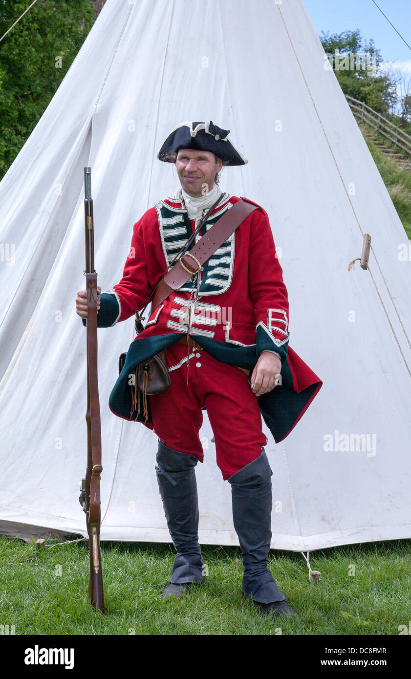 English redcoat, holding Brown Bess Musket, standing as