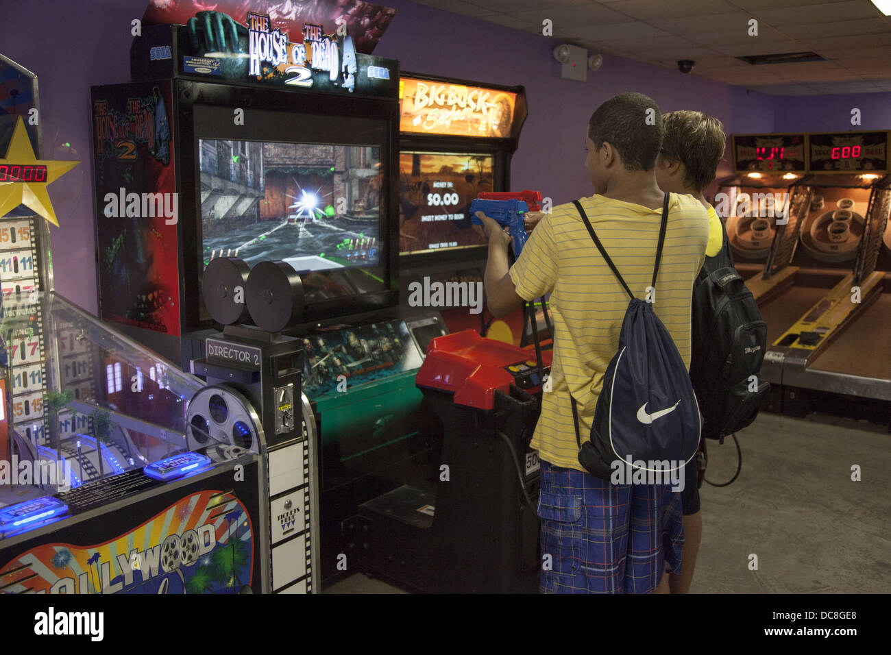 Kids always are in battle mode with the violent games at a video arcade in Coney Island, Brooklyn, NY. - Stock Image