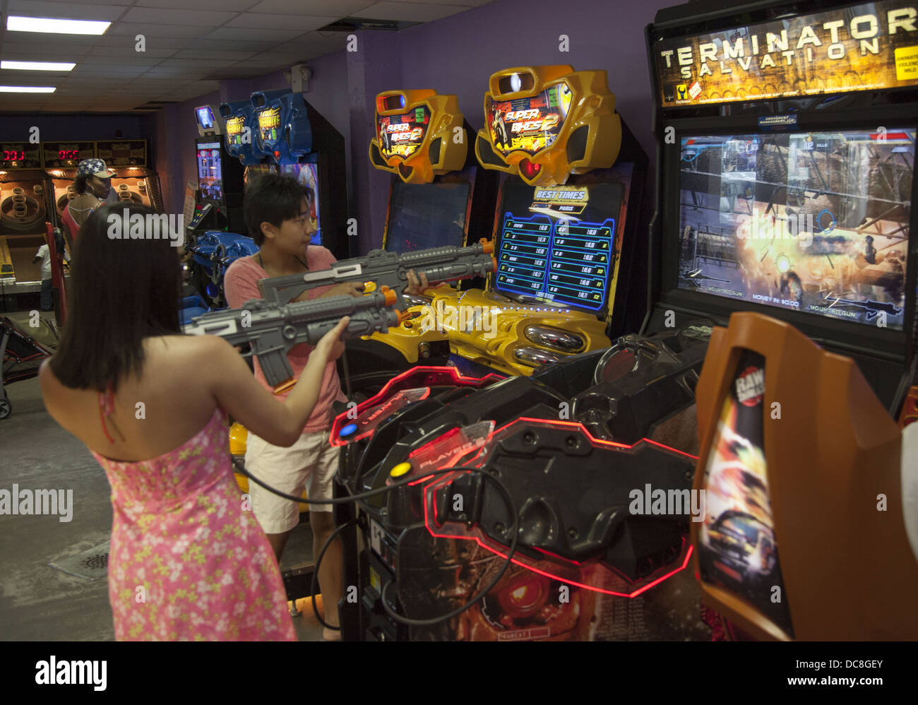 Kids always are in battle mode with the violent games at a video arcade in Coney Island, Brooklyn, NY. Stock Photo