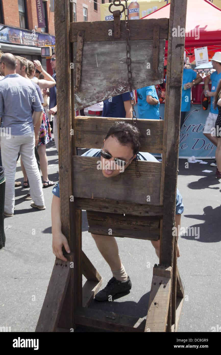 Man imagines what it was like back when during the French Revolution. Guillotine, Bastille Day, Brooklyn, New York. - Stock Image