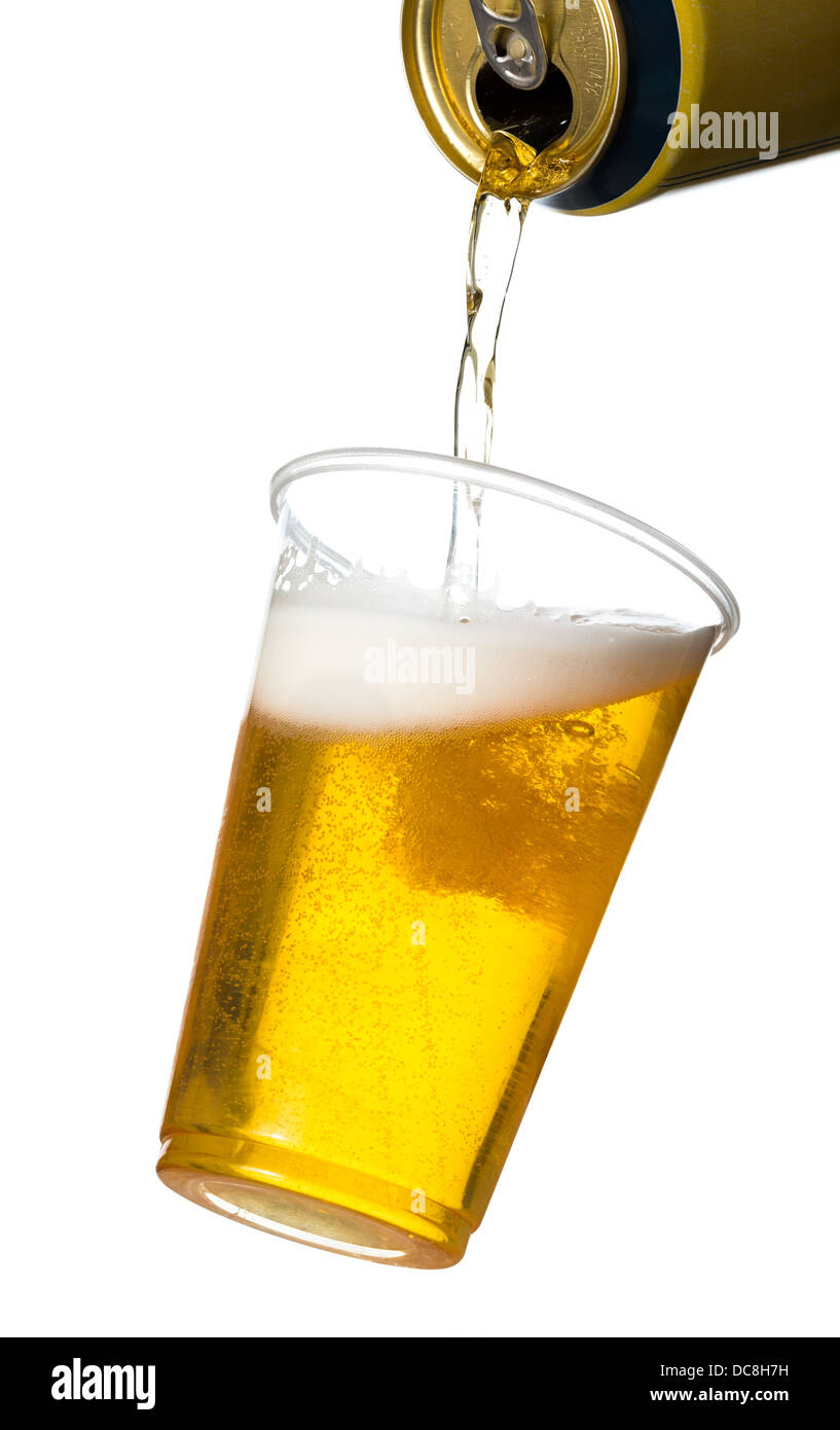 Pouring lager beer into plastic disposable pint glass - Stock Image