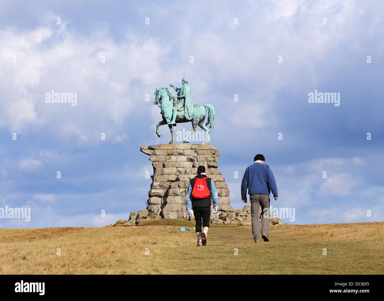 The Copper Horse statue of George III on Snow Hill in Windsor Great Park with walkers passing by - Stock Image