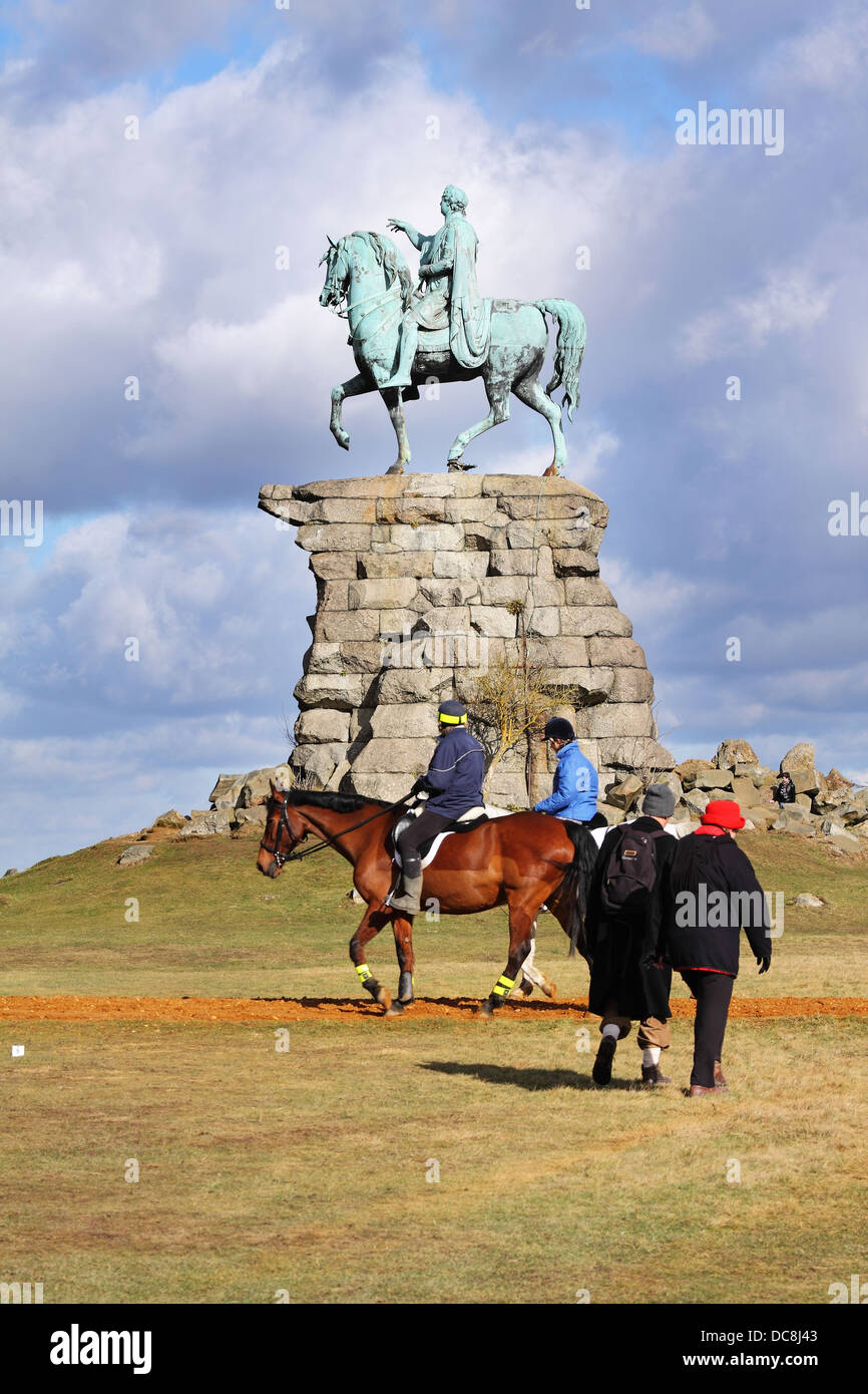 The Copper Horse statue of George III on Snow Hill in Windsor Great Park with walkers and horse riders passing by - Stock Image