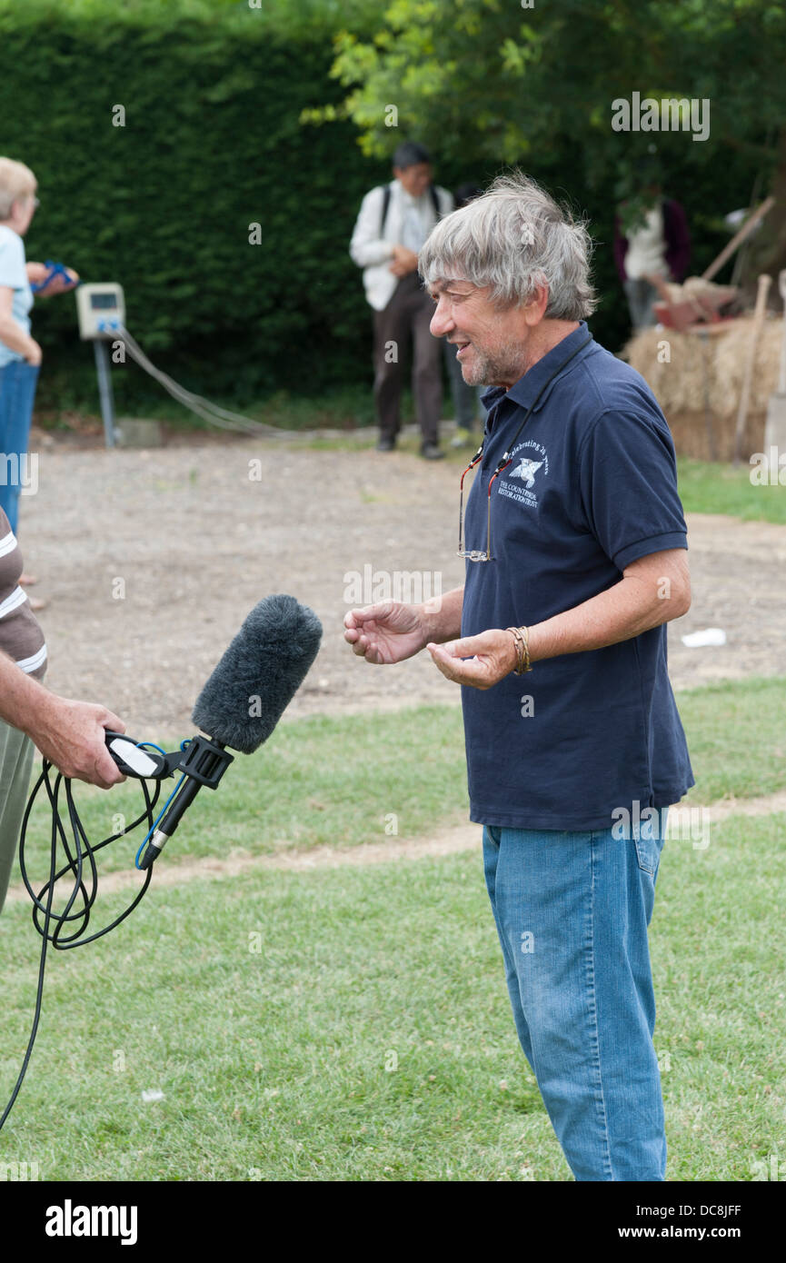 Robin Page farmer broadcaster and journalist giving a radio interview - Stock Image
