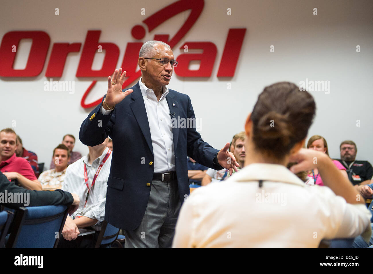 NASA Administrator Charles Bolden speaks with Orbital Sciences Corporation employees after touring the the Orbiting - Stock Image