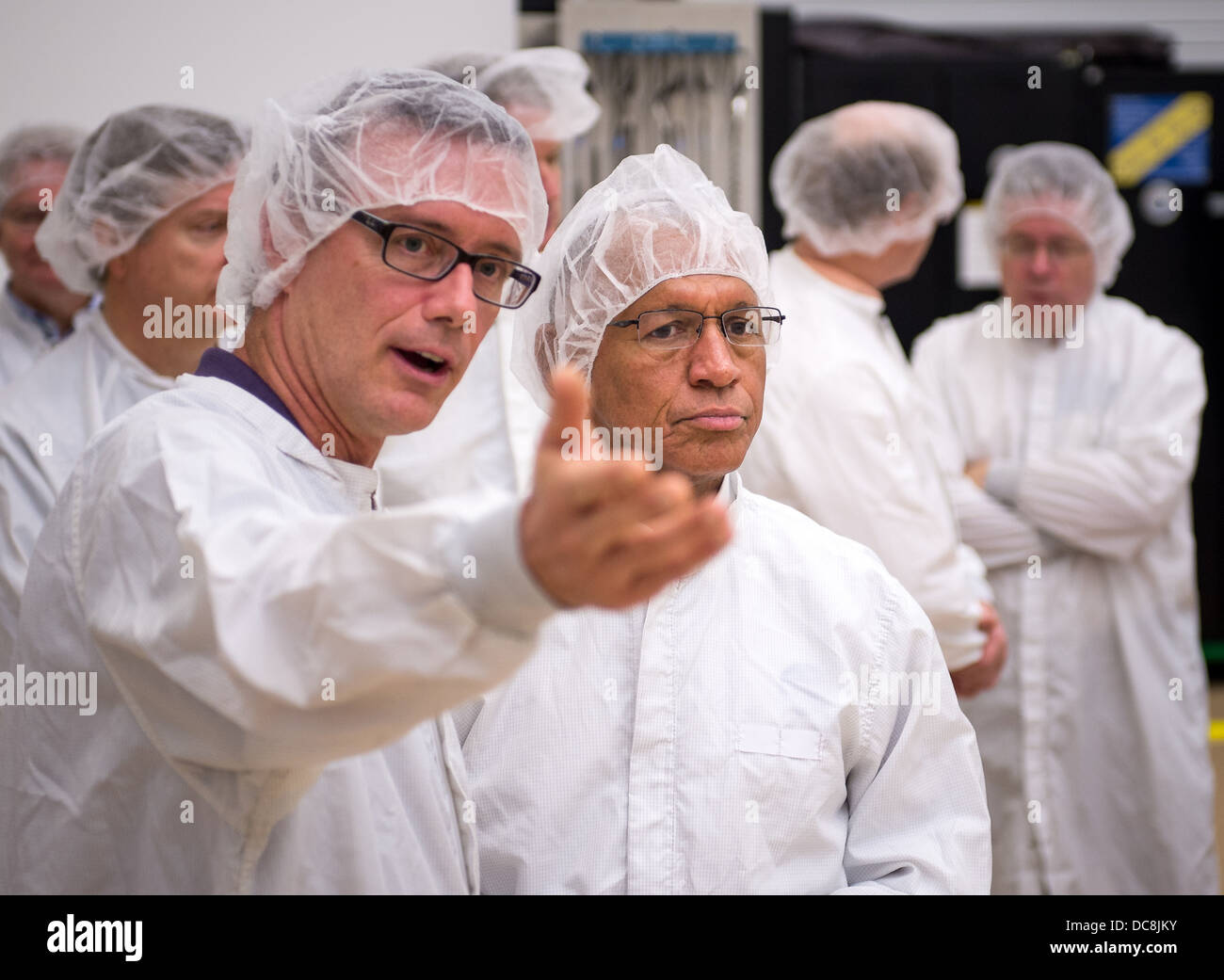 NASA Administrator Charles Bolden, right, listens as Tom Jones from Orbital Sciences Corporation talks about the - Stock Image