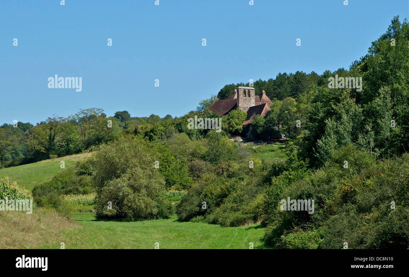 The hamlet of Saint-Cernin-de-Reilhac, bell gable of church Saint-Saturnin, in Rouffignac, Dordogne. - Stock Image