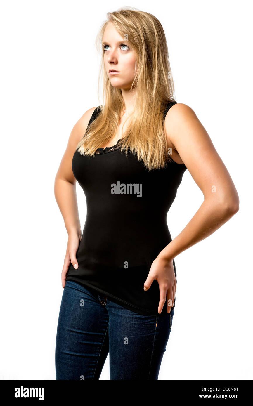 Amazed blonde girl with blue eyes looks upwards isolated on white background - Stock Image