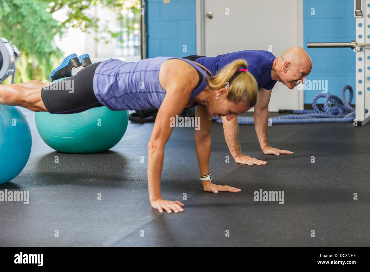 Particpants working out at a private fitness studio. - Stock Image