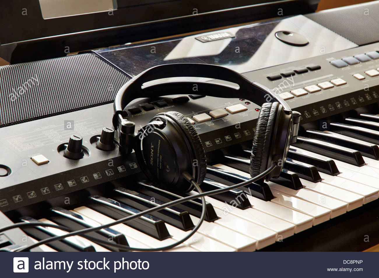 pair sony headphones on the piano keys of a yamaha electronic rh alamy com Sony DAV HDX576WF Manual Sony Operating Manuals