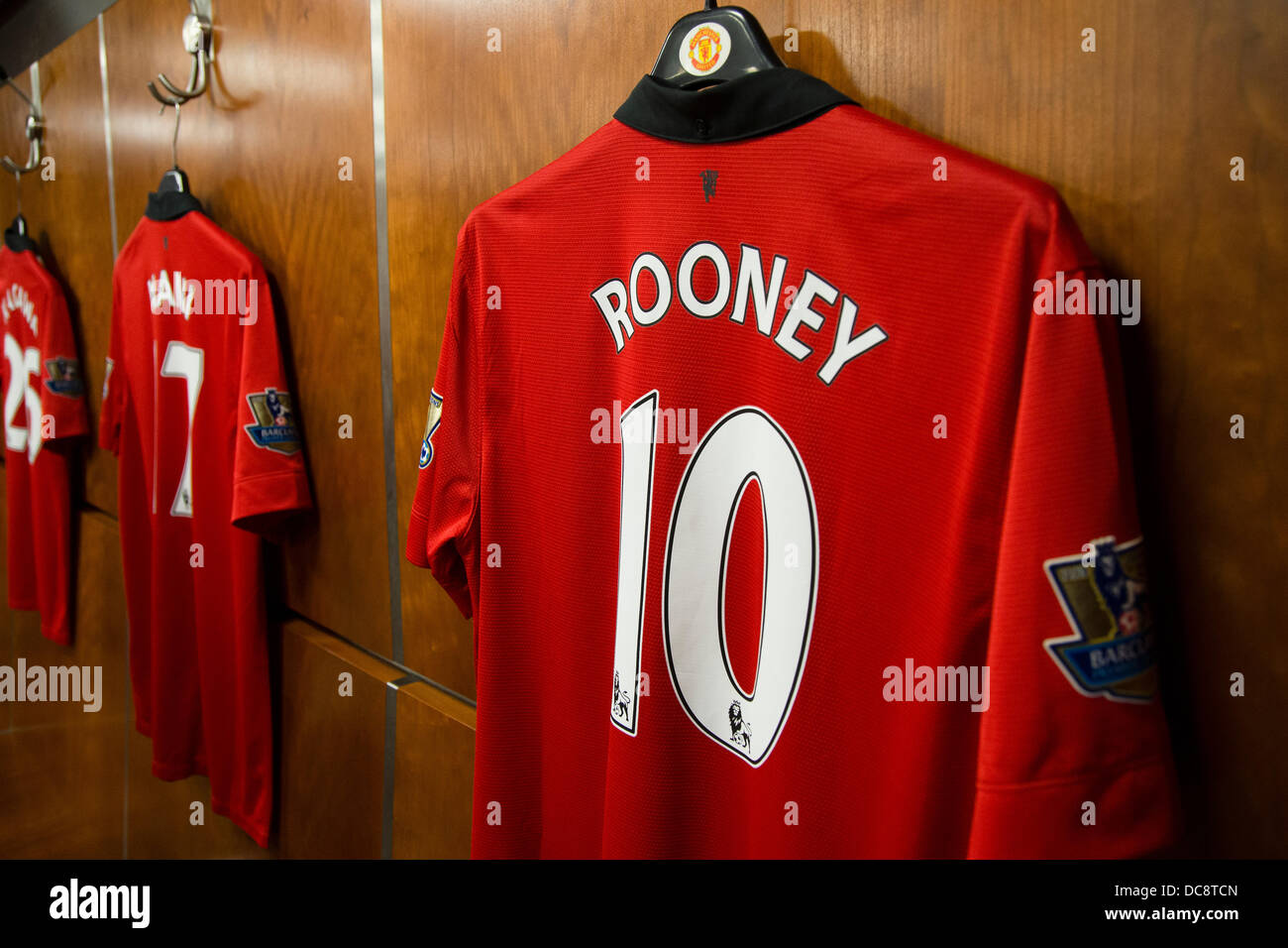 Wayne Rooney's Manchester United football shirt hanging in the old trafford home dressing room - Stock Image