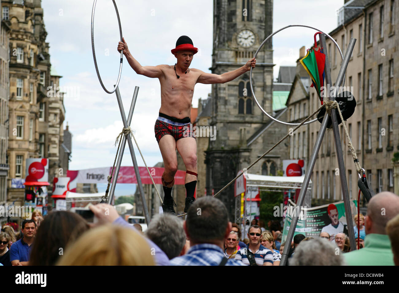 Edinburgh, Scotland, UK, Monday, 12th August, 2013. A Street Performer juggling and slack rope walking on the Royal Stock Photo