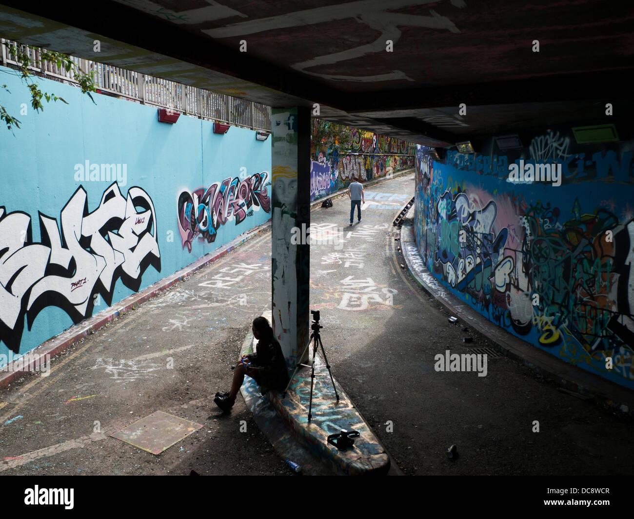 People in the Leake Street Grafitti Tunnel, Lambeth London England UK  KATHY DEWITT - Stock Image