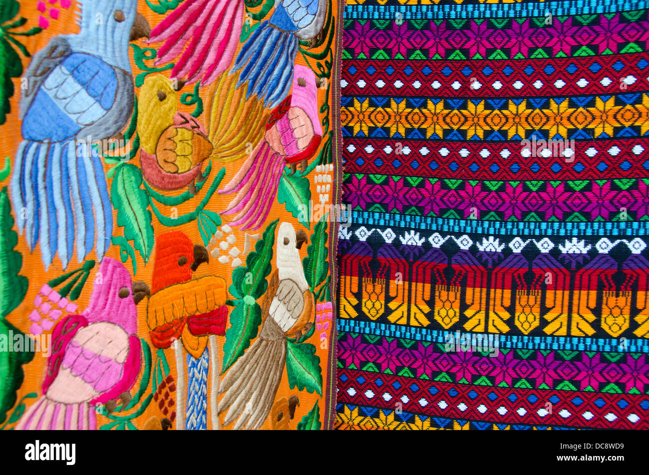 Guatemala, Livingston. Colorful traditional embroidery textile with tropical birds, specialty of Guatemala. - Stock Image