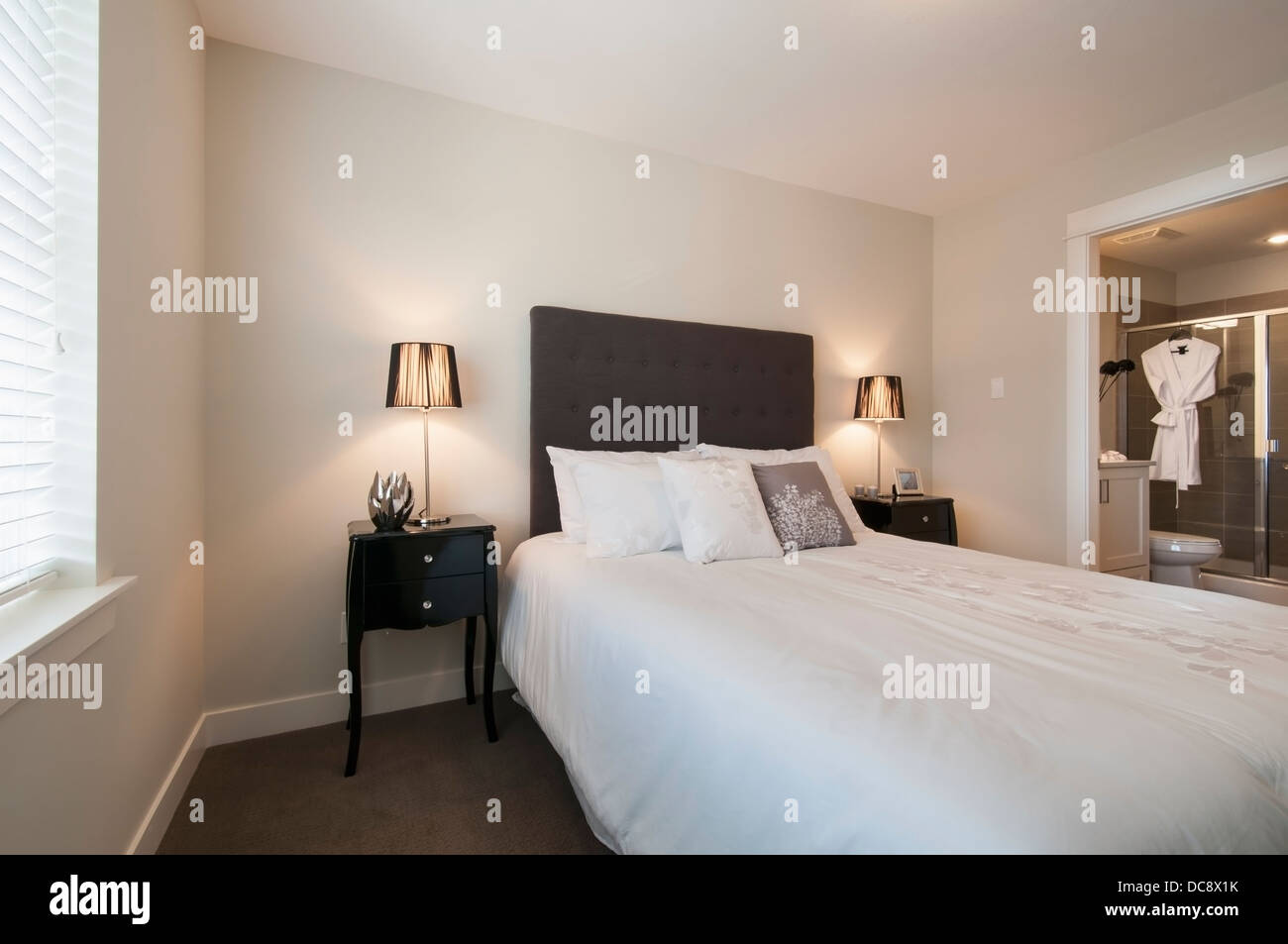 A Bed In Bedroom With An Attached Bathroom Surrey British Columbia Canada
