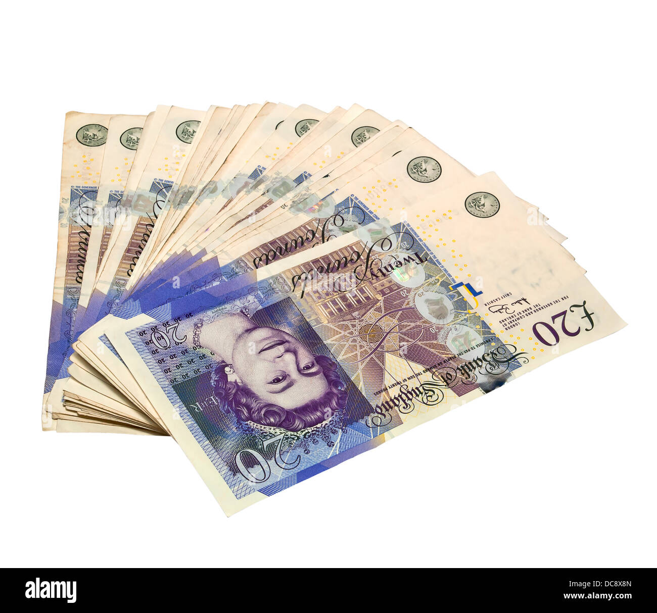 20 pound notes spread out with clipping path - Stock Image