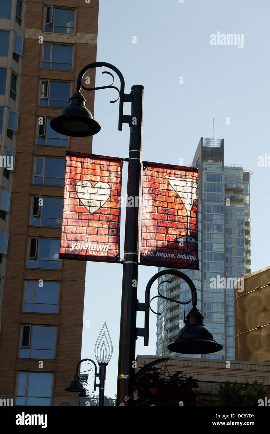 Banners hanging from a lamp post in Yaletown, Vancouver, British Columbia, Canada - Stock Image