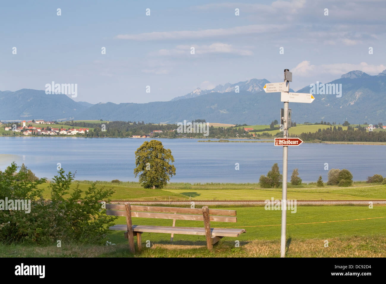 Europe, Germany, Bavaria, Ostallgäu, Hopferau, view of the Hopfensee with Hopfen am See and  the Alps in the background Stock Photo