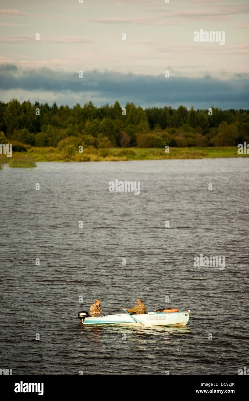 Scenic view of Volga River and recreational fishermen Russia - Stock Image