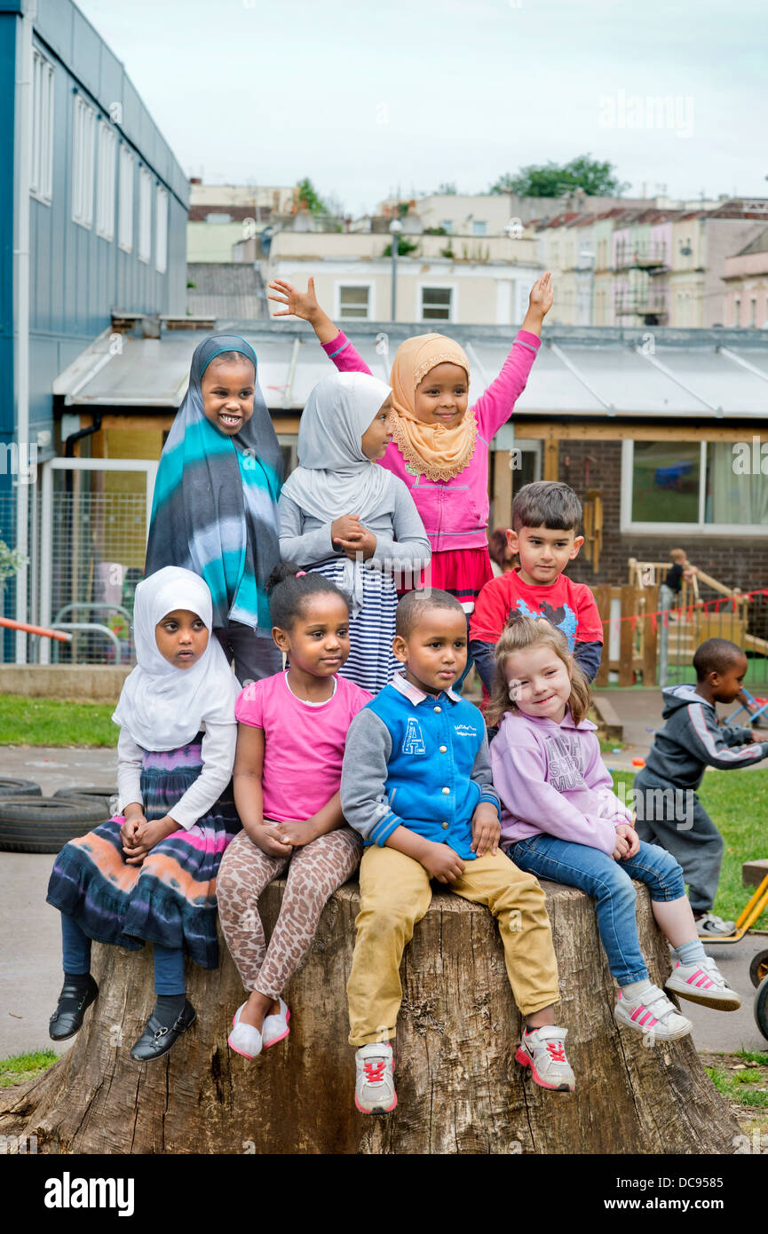 The St. Pauls Nursery School and Children's Centre, Bristol UK  - A culturally diverse group of children in - Stock Image