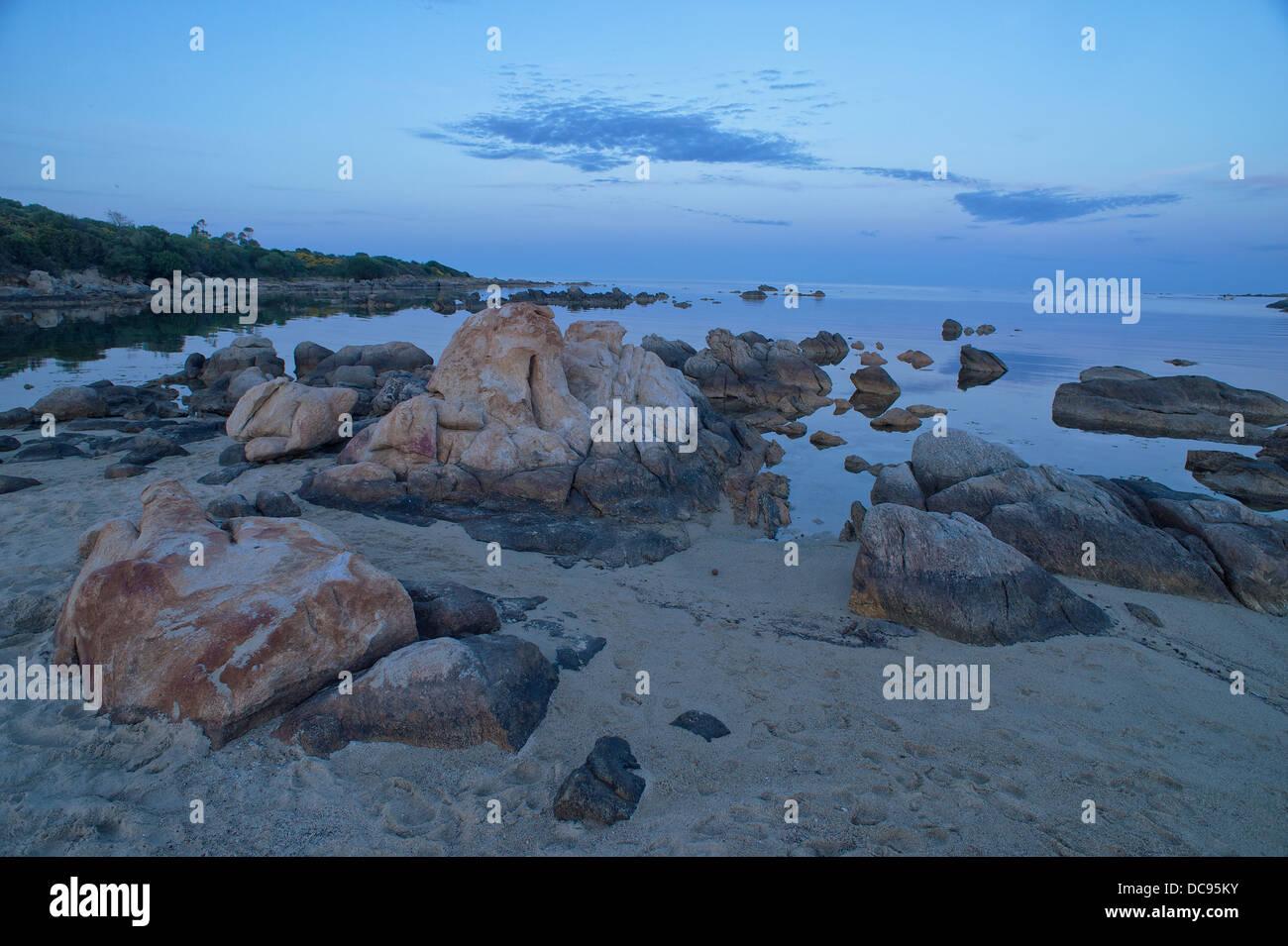 Rocks on the beach of Ottiolu, Sardinia - Stock Image