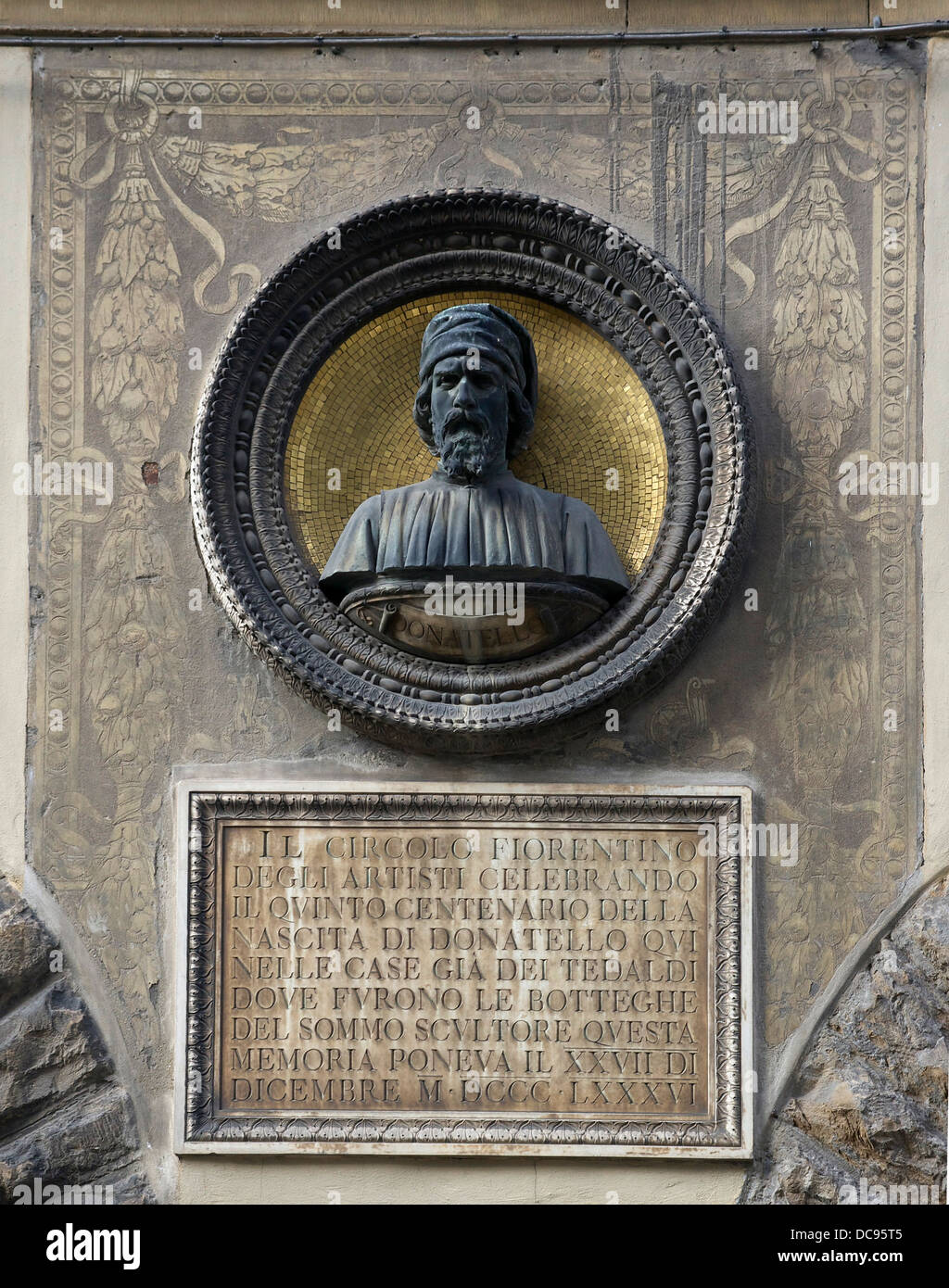 Tribute to Donatello, on the façade of the Palazzo Naldini in Florence, Italy. - Stock Image