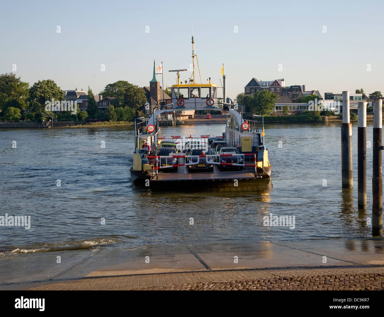 Car ferry arriving at Kinderdijk across the River Lek from Krimpen aan de Lek Netherlands - Stock Image
