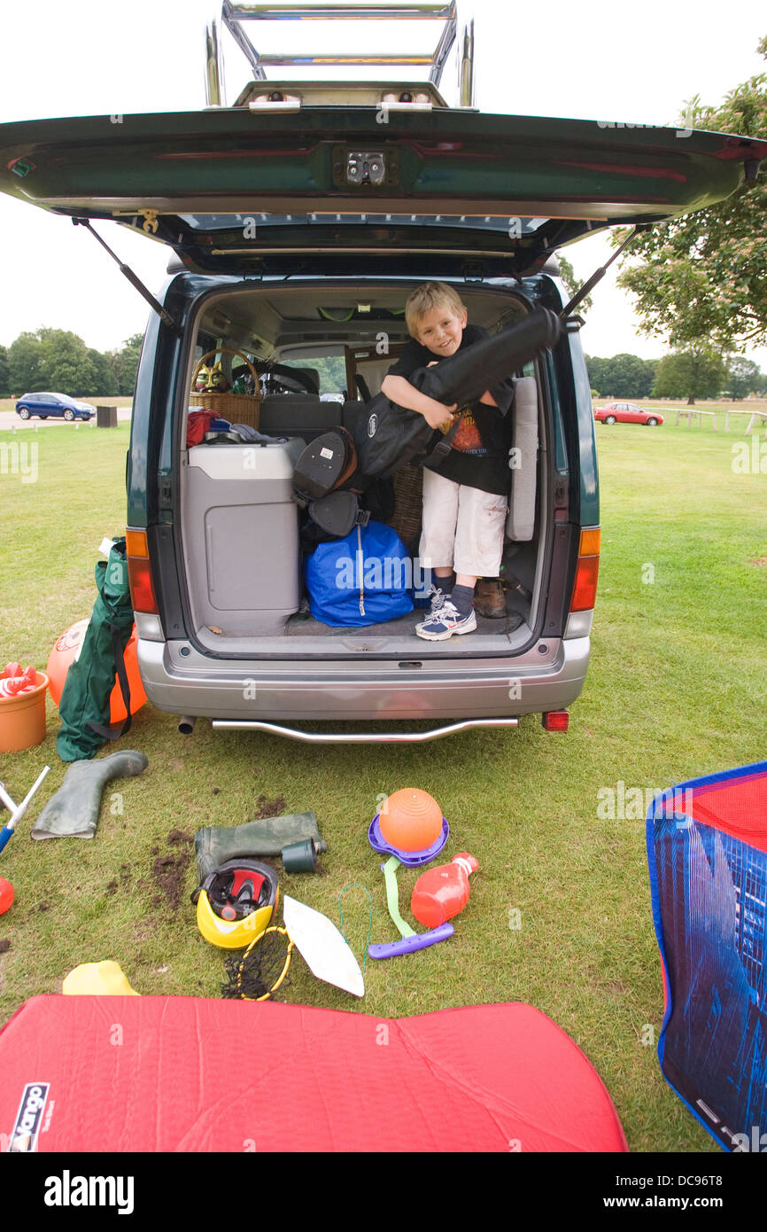 Father and son with their modern camping van. - Stock Image