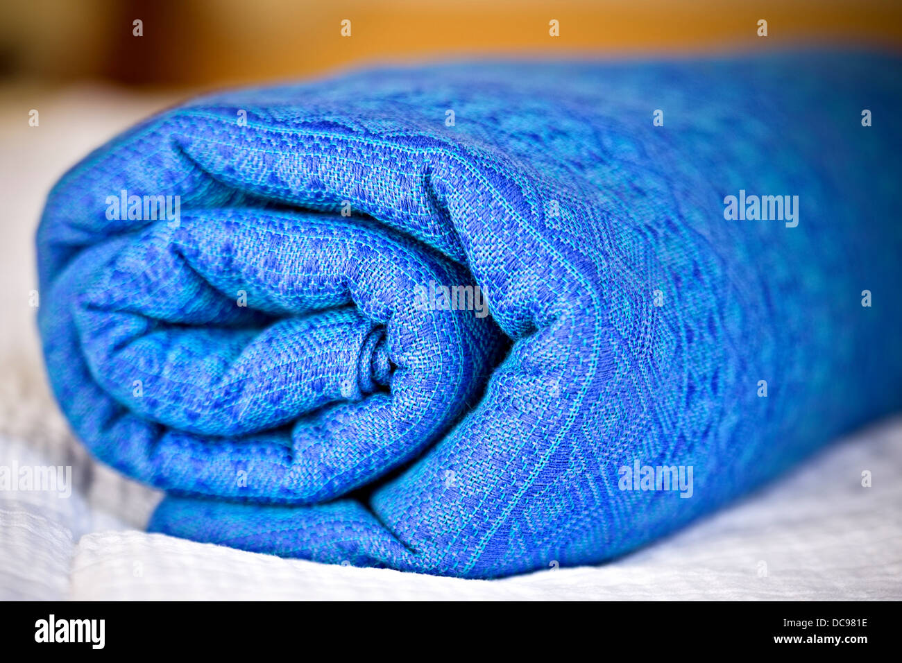 closeup of rolled blue baby sling - Stock Image