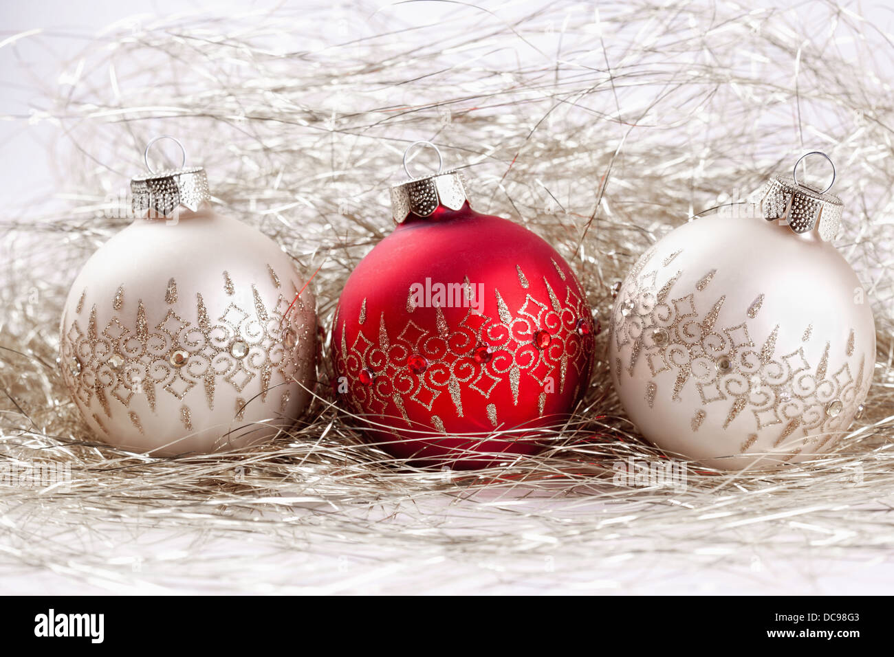 background from christmas balls with tinsel - Stock Image
