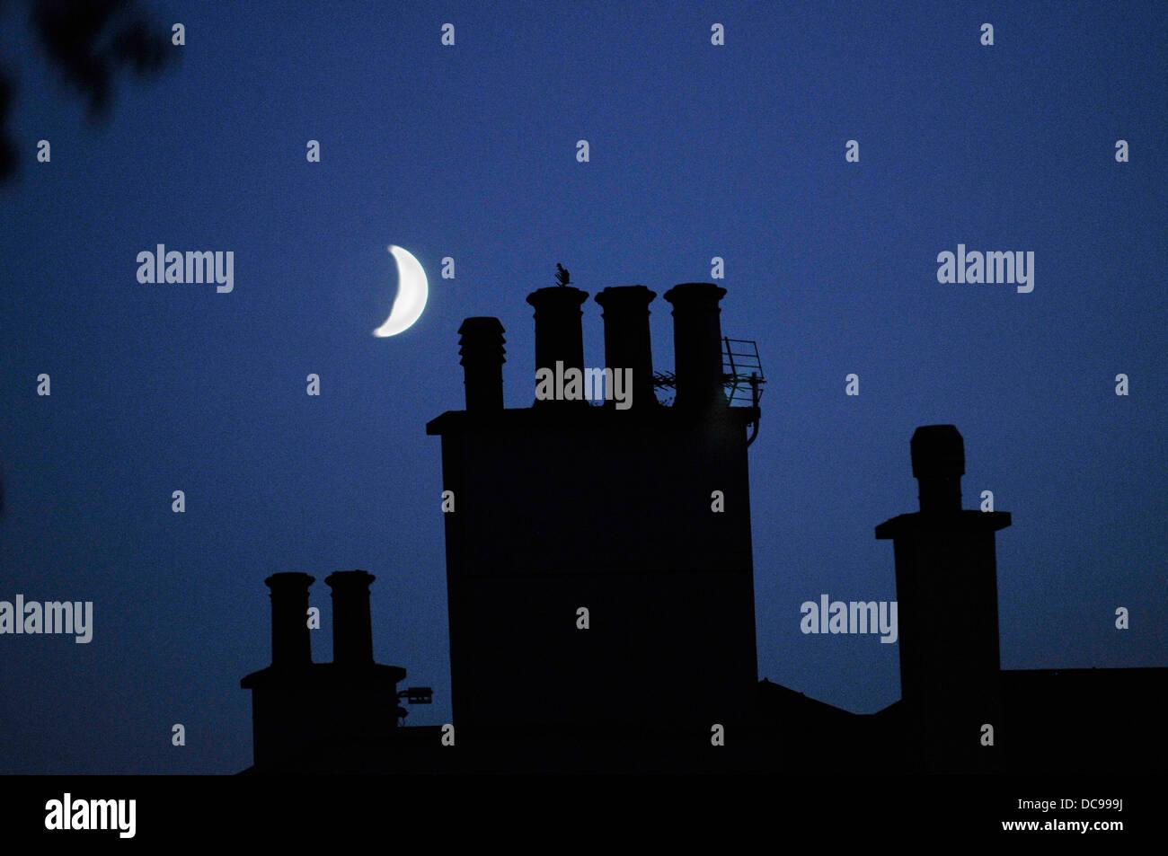 Moon and chimney pots UK - Stock Image
