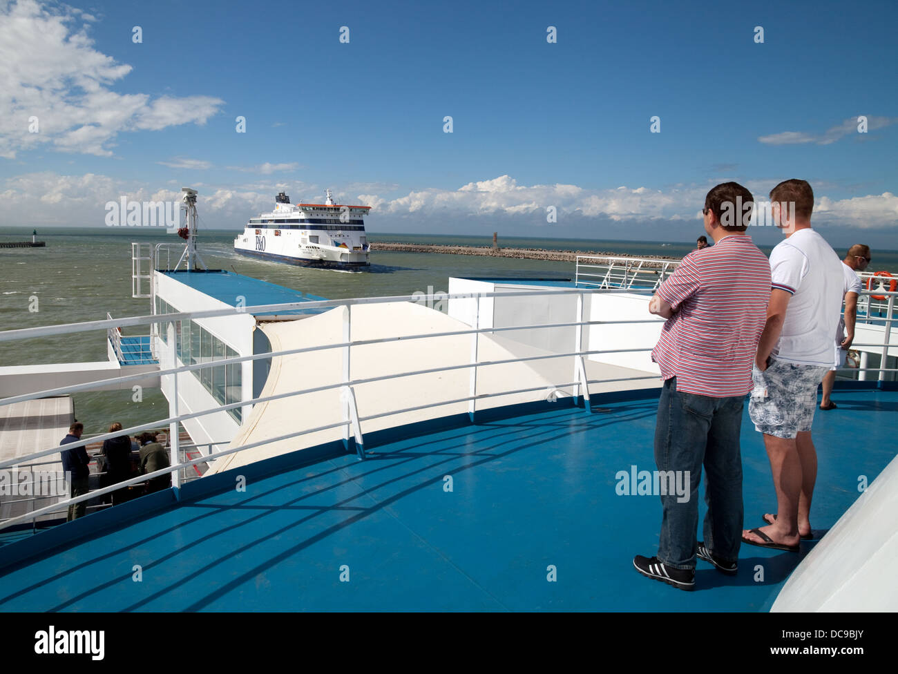 Passengers aboard the MyFerryLink cross channel ferry 'Rodin' as it leaves Calais for Dover - Stock Image