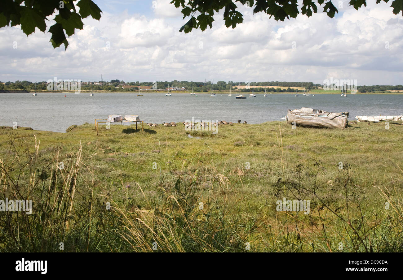 Boats River Stour estuary view Manningtree Essex England - Stock Image