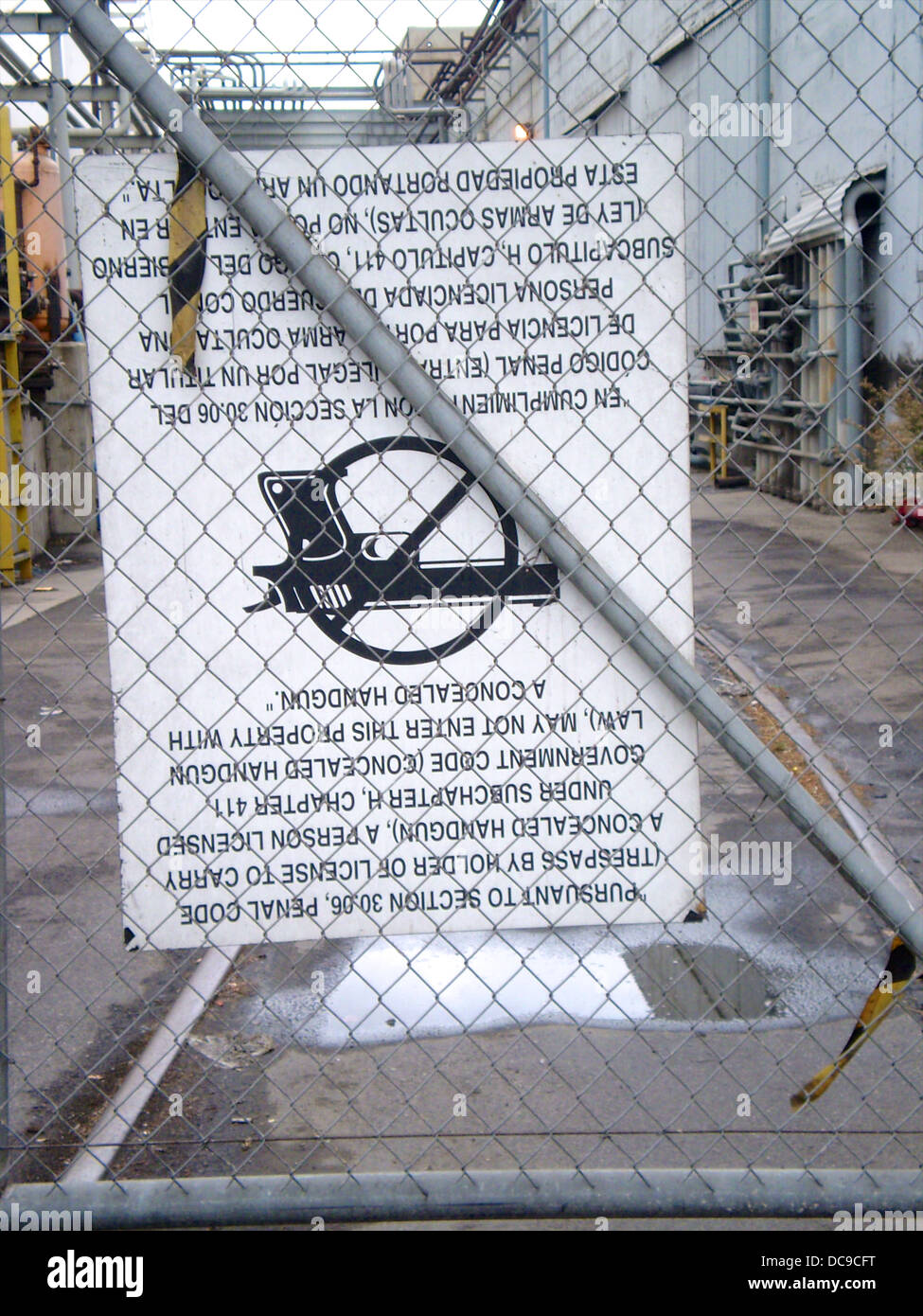 Upside down gun not permitted sign. - Stock Image