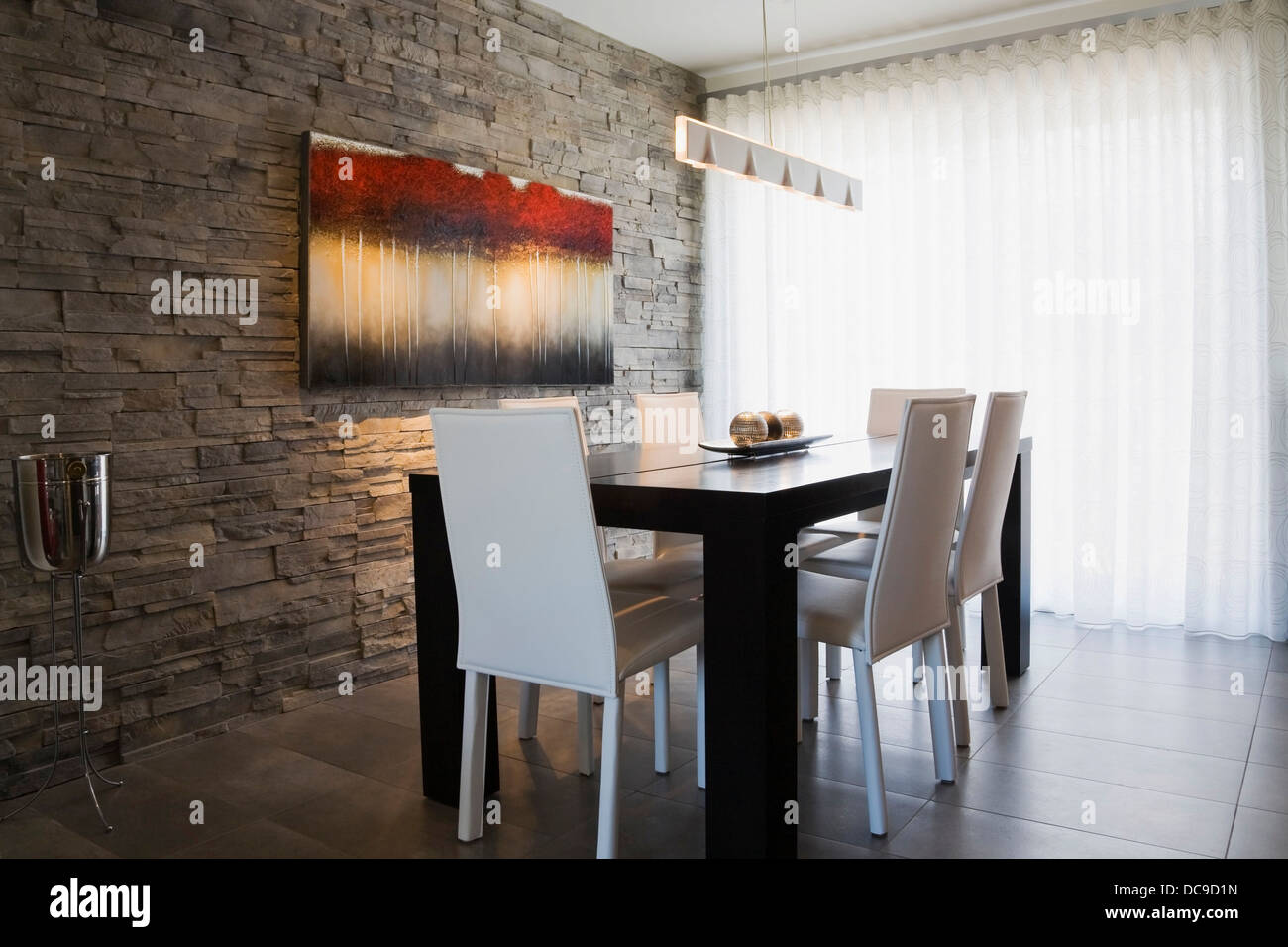 Dining room inside a modern residential home - Stock Image