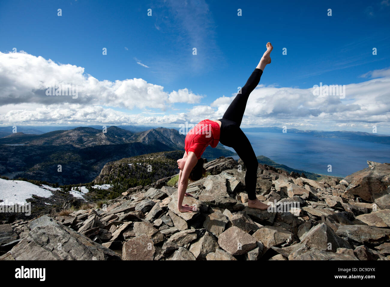 A Woman Performs Yoga On Top Of Mount Tallac Overlooking Lake Tahoe Stock Photo Alamy