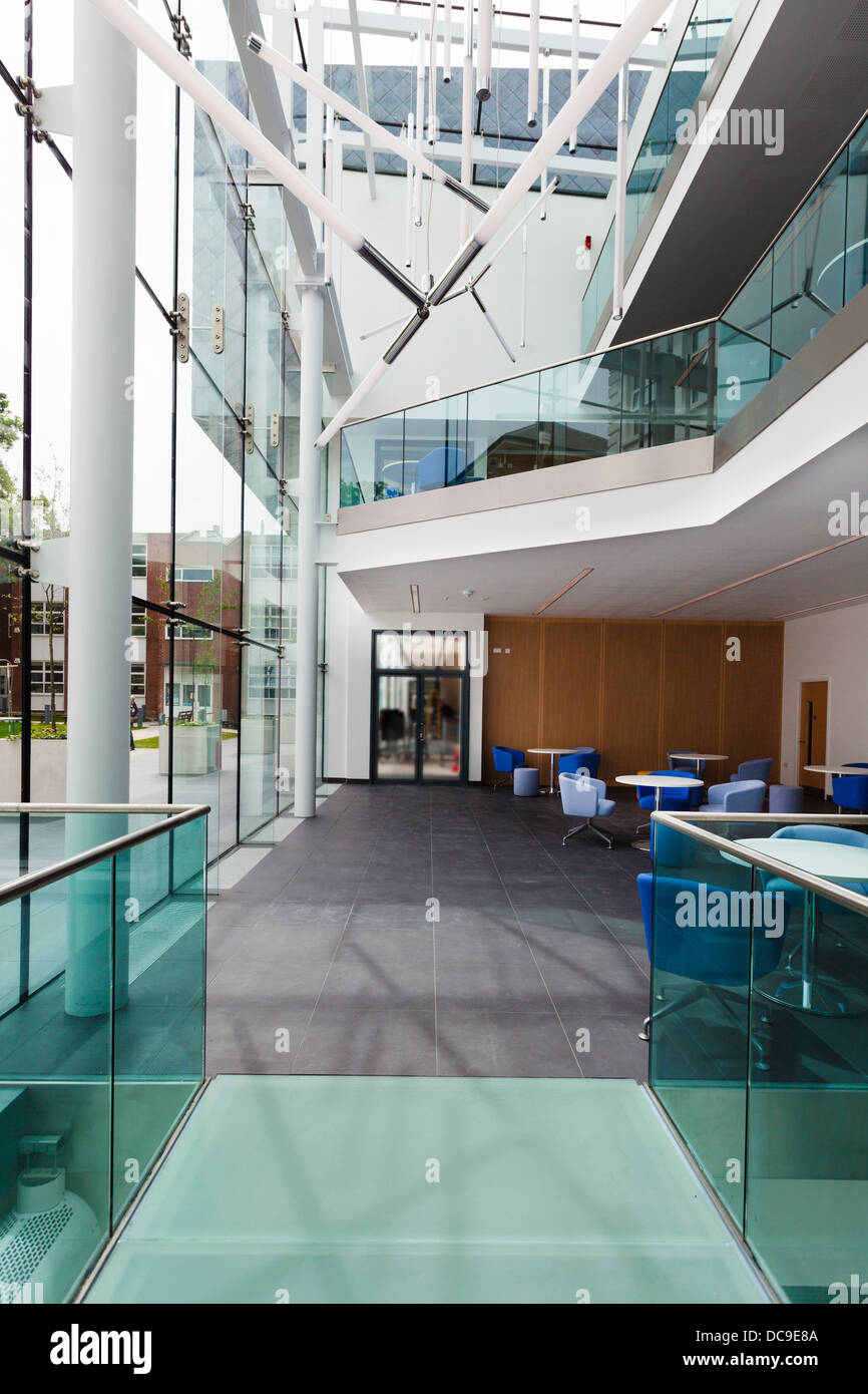glass walled extension hallway to Notting Hill Ealing High School - Stock Image