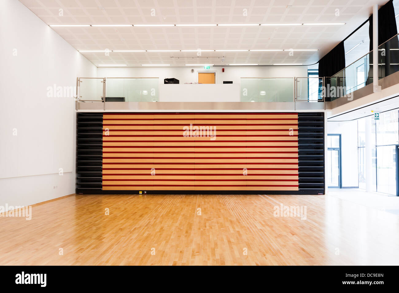 closed retractable seating in school hall at Notting Hill Ealing High School - Stock Image